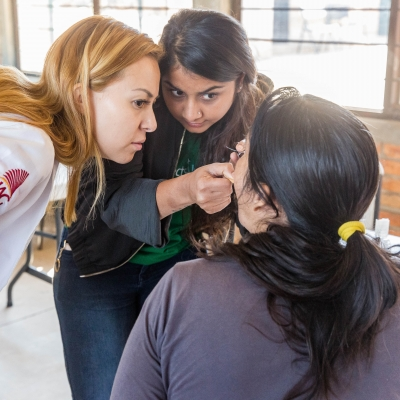 Interns help at a medical outreach as part of their public health work in Mexico with a group.